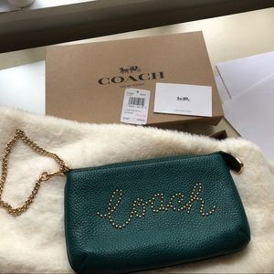 Coach Bags - ❌SOLD❌ 🔥Large Wristlet with Coach Studded Script